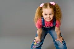 女孩牛仔裤一点所有佩带 免版税库存图片