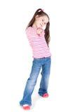 女孩牛仔裤指向您的一点 免版税库存图片