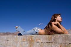 女孩牛仔裤 免版税图库摄影