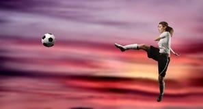 女孩球员足球 免版税库存照片
