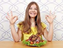 女孩用丸子和好手标志 图库摄影