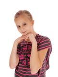 女孩用在下巴下的手 免版税库存照片