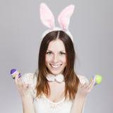 女孩用复活节彩蛋 免版税库存图片