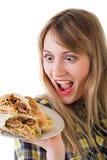女孩用快餐 免版税图库摄影