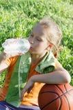 女孩用篮球和水 免版税库存照片