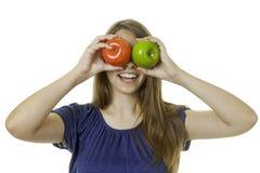 女孩用苹果 免版税库存照片