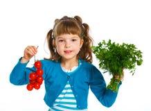 女孩用蕃茄 图库摄影