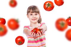 女孩用蕃茄 库存图片