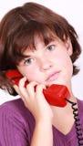 女孩电话联系 免版税库存图片