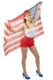 女孩的性感的别针隔绝了拿着一面美国国旗 库存图片