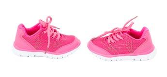 女孩的桃红色训练鞋子 库存图片