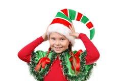 女孩的纵向礼服矮子的圣诞老人。 免版税库存图片