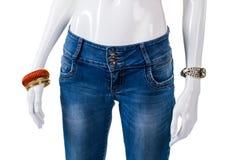女孩的蓝色皮包骨头适合牛仔裤 免版税图库摄影