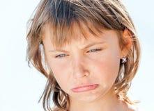 女孩的被触犯的面孔 免版税库存图片