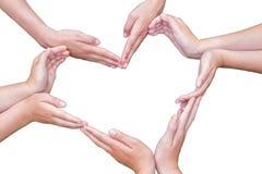 女孩的许多胳膊修建在白色的心脏 免版税库存照片