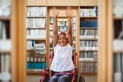 女孩的综合图象轮椅的在学校走廊 库存照片