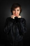 女孩皮革成套装备岩石 免版税库存照片