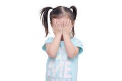 女孩盖她的面孔移交白色 库存照片
