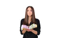 女孩礼服的和有一团的金钱在她的手上 库存照片