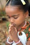 女孩祈祷的一点 图库摄影