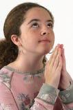女孩祈祷青少年 免版税库存图片