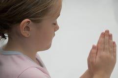 女孩祈祷 免版税图库摄影