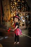 女孩神仙,笤帚的巫婆用南瓜 万圣节 库存照片