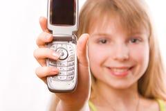 女孩移动电话俏丽的少年 库存图片