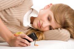 女孩移动电话少年使用 免版税库存照片