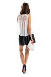 女孩穿着短裙 免版税库存照片