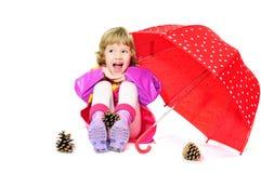 女孩笑的伞 免版税图库摄影