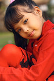 女孩红色佩带 免版税图库摄影