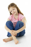 女孩纵向微笑的工作室 免版税库存图片