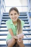 女孩纵向微笑的非离子活性剂 库存图片
