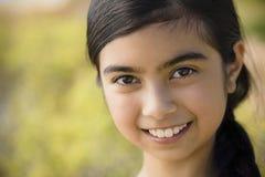 女孩纵向微笑 库存照片
