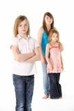 女孩编组一起查找不快乐的工作室 库存照片