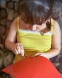 女孩缝合 免版税库存照片