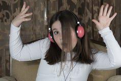 女孩耳机一点 免版税库存图片