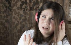 女孩耳机一点 图库摄影
