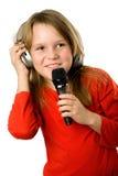 女孩耳机相当少许话筒 免版税图库摄影