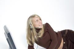 女孩耳机话筒 免版税库存图片