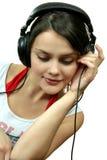 女孩耳机 库存图片