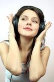 女孩耳机 免版税图库摄影