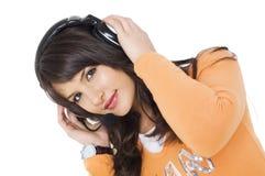 女孩耳机 免版税库存照片