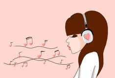 女孩耳机 免版税库存图片