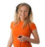 女孩耳机MP3播放器微笑 免版税库存照片