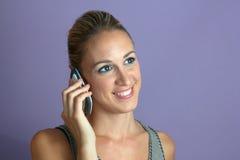 女孩联系在移动电话 免版税库存照片