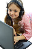 女孩膝上型计算机一点 免版税图库摄影