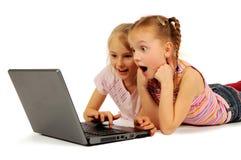 女孩膝上型计算机一点 免版税库存图片