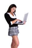 女孩膝上型计算机学校 库存照片